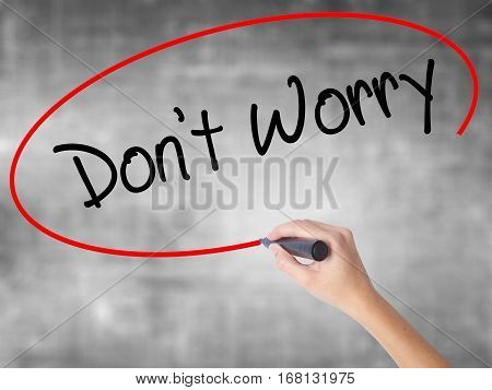 Woman Hand Writing Don't Worry With Black Marker Over Transparent Board