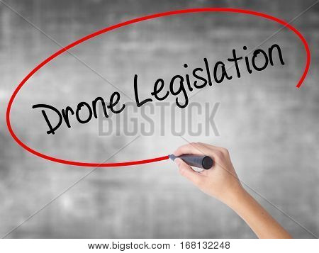 Woman Hand Writing Drone Legislation With Black Marker Over Transparent Board