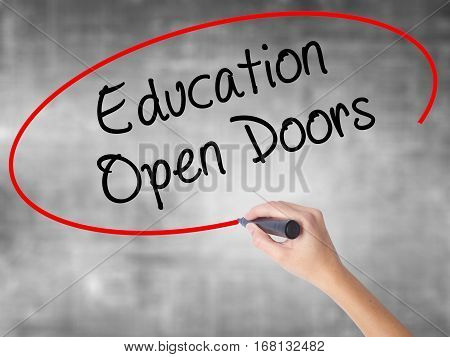 Woman Hand Writing Education Open Doors With Black Marker Over Transparent Board