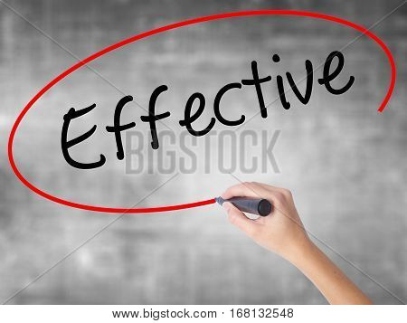 Woman Hand Writing Effective With Black Marker Over Transparent Board.