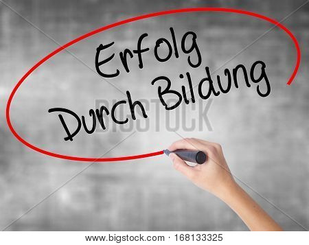 Woman Hand Writing Erfolg Durch Bildung  (success Through Training In German) With Black Marker Over