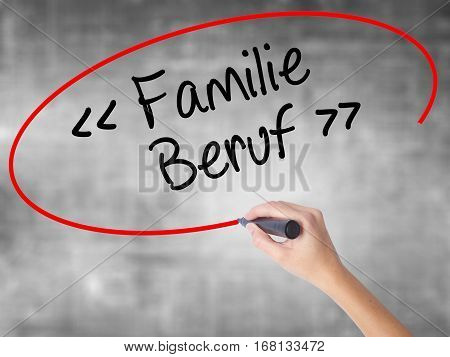 Woman Hand Writing Familie Beruf (family Occupation In German) With Black Marker Over Transparent Bo