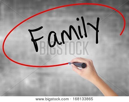 Woman Hand Writing Family With Black Marker Over Transparent Board