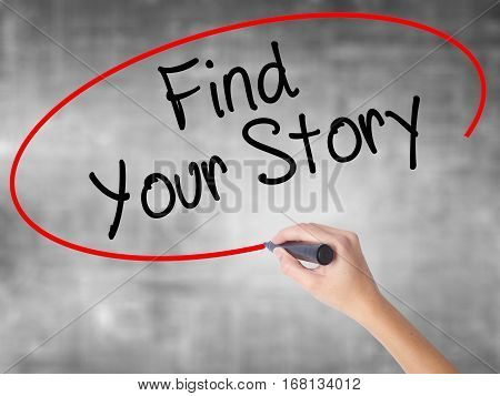 Woman Hand Writing Find Your Story With Black Marker Over Transparent Board