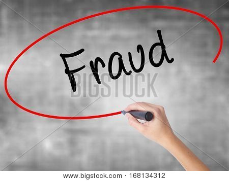 Woman Hand Writing Fraud With Black Marker Over Transparent Board
