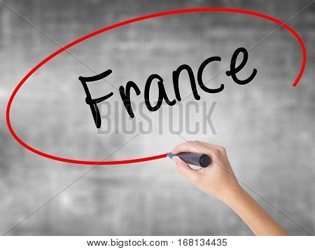 Woman Hand Writing France With Black Marker Over Transparent Board