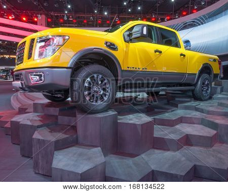 DETROIT MI/USA - JANUARY 13 2015: 2016 Nissan Titan XD truck at the North American International Auto Show (NAIAS) one of the most influential car shows in the world each year.