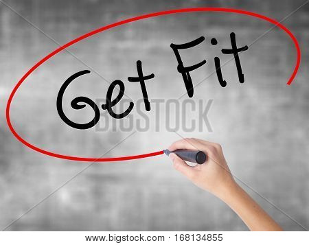 Woman Hand Writing Get Fit  With Black Marker Over Transparent Board