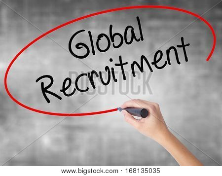 Woman Hand Writing Global Recruitment With Black Marker Over Transparent Board