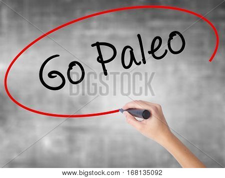 Woman Hand Writing Go Paleo With Black Marker Over Transparent Board