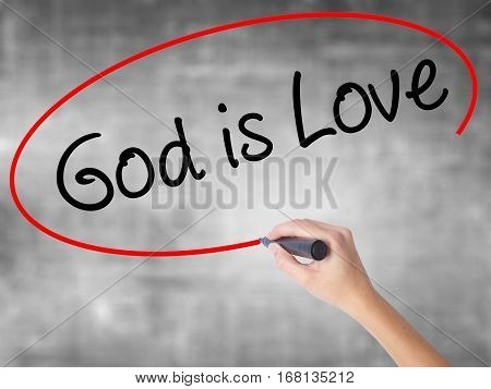 Woman Hand Writing God Is Love With Black Marker Over Transparent Board