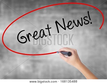 Woman Hand Writing Great News! With Black Marker Over Transparent Board