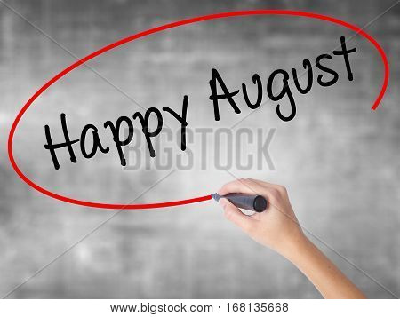 Woman Hand Writing Happy August With Black Marker Over Transparent Board