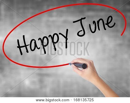 Woman Hand Writing Happy June With Black Marker Over Transparent Board