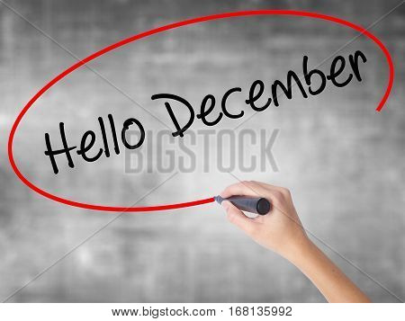 Woman Hand Writing Hello December No With Black Marker Over Transparent Board
