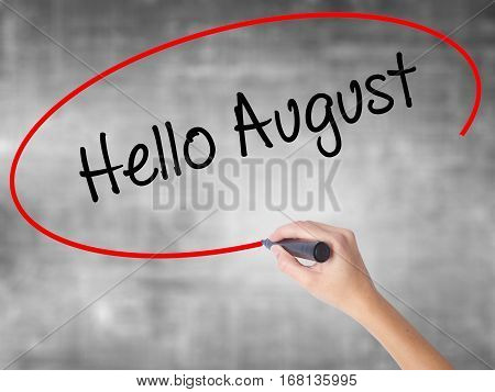 Woman Hand Writing Hello August With Black Marker Over Transparent Board