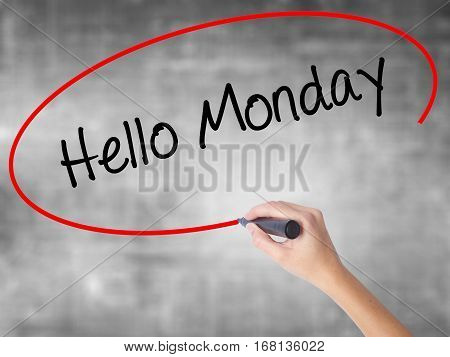 Woman Hand Writing Hello Monday With Black Marker Over Transparent Board