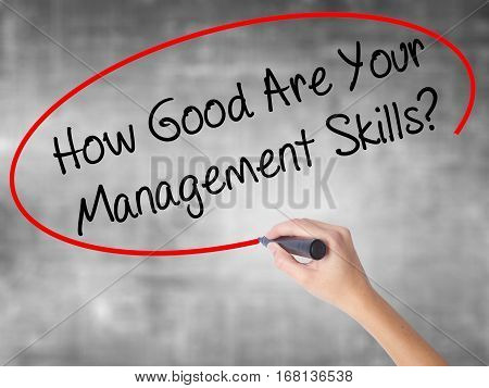 Woman Hand Writing How Good Are Your Management Skills? With Black Marker Over Transparent Board