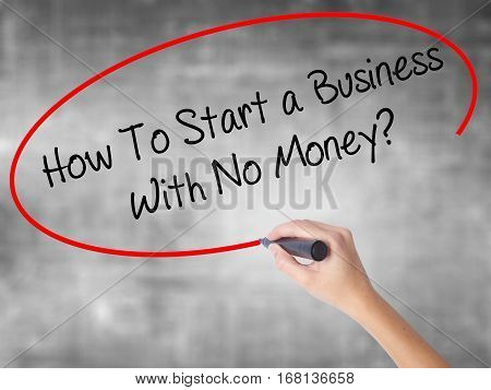 Woman Hand Writing How To Start A Business With No Money? With Black Marker Over Transparent Board