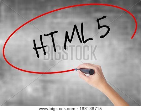 Woman Hand Writing Html 5 With Black Marker Over Transparent Board