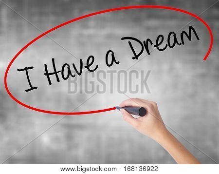 Woman Hand Writing I Have A Dream With Black Marker Over Transparent Board