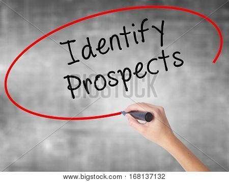 Woman Hand Writing Identify Prospects With Black Marker Over Transparent Board
