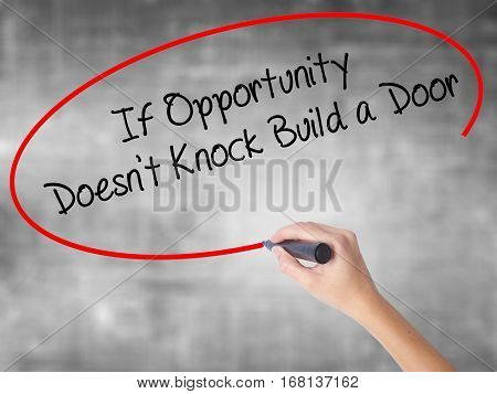 Woman Hand Writing If Opportunity Doesn't Knock Build A Door With Black Marker Over Transparent Boar