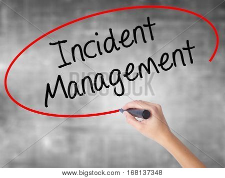 Woman Hand Writing Incident Management With Black Marker Over Transparent Board