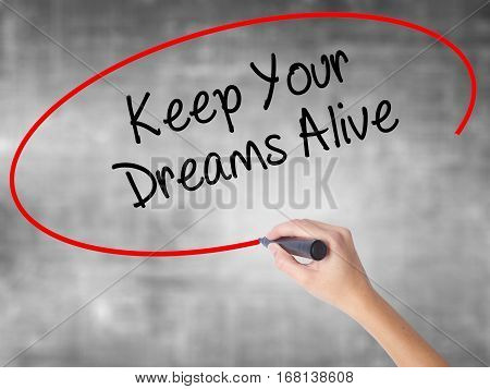 Woman Hand Writing Keep Your Dreams Alive With Black Marker Over Transparent Board