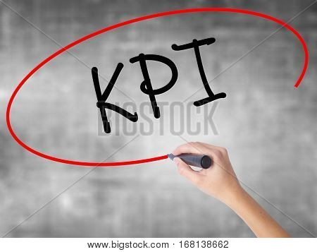 Woman Hand Writing Kpi (key Performance Indicator) With Black Marker Over Transparent Board