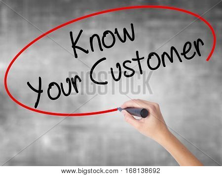 Woman Hand Writing Know Your Customer With Black Marker Over Transparent Board
