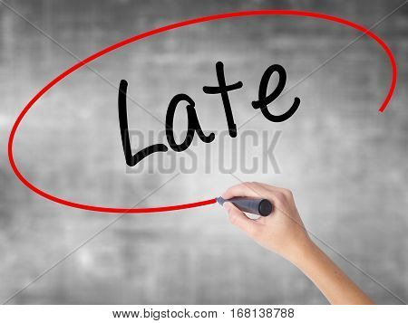 Woman Hand Writing Late With Black Marker Over Transparent Board