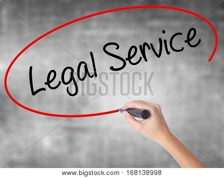 Woman Hand Writing Legal Service With Black Marker Over Transparent Board