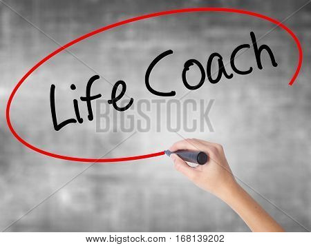 Woman Hand Writing Life Coach With Black Marker Over Transparent Board