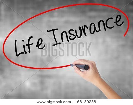 Woman Hand Writing Life Insurance With Black Marker Over Transparent Board