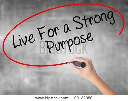 Woman Hand Writing Live For A Strong Purpose With Black Marker Over Transparent Board