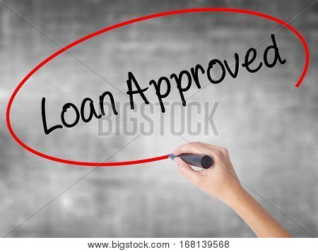 Woman Hand Writing Loan Approved With Black Marker Over Transparent Board