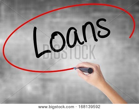 Woman Hand Writing Loans  With Black Marker Over Transparent Board