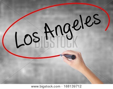 Woman Hand Writing Los Angeles With Black Marker Over Transparent Board