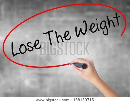 Woman Hand Writing Lose The Weight With Black Marker Over Transparent Board