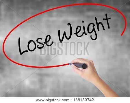 Woman Hand Writing Lose Weight With Black Marker Over Transparent Board