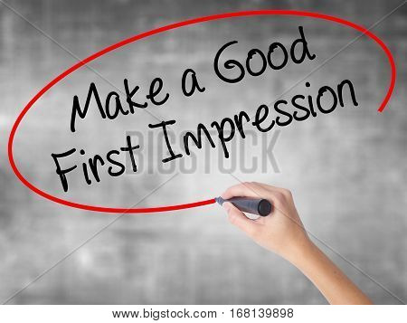 Woman Hand Writing Make A Good First Impression With Black Marker Over Transparent Board
