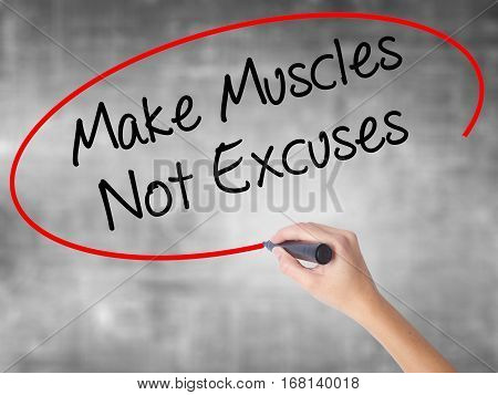 Woman Hand Writing Make Muscles Not Excuses With Black Marker Over Transparent Board