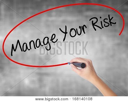 Woman Hand Writing Manage Your Risk With Black Marker Over Transparent Board