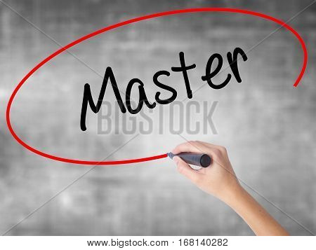 Woman Hand Writing Master With Black Marker Over Transparent Board