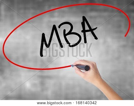 Woman Hand Writing Mba With Black Marker Over Transparent Board