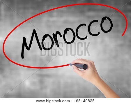 Woman Hand Writing Morocco  With Black Marker Over Transparent Board