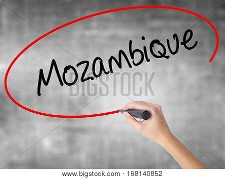 Woman Hand Writing Mozambique  With Black Marker Over Transparent Board