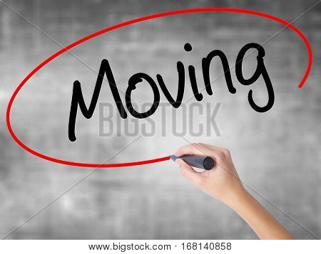 Woman Hand Writing Moving With Black Marker Over Transparent Board