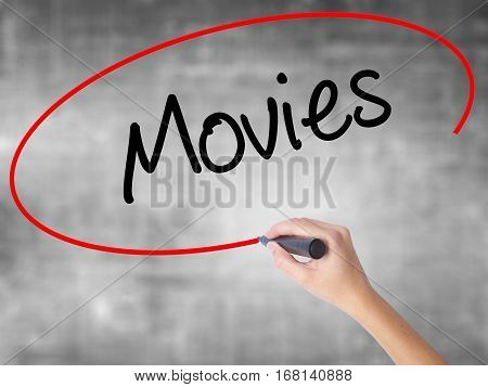 Woman Hand Writing  Movies With Black Marker Over Transparent Board
